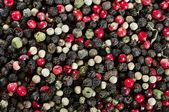 Mixed red, white and black pepper corn seeds — Stock Photo