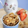 Stock Photo: Bran flakes cereal in blue bowl