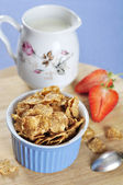 Bran flakes cereal in blue bowl — Stock Photo
