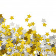 Golden and silver star confetti — Stock Photo