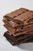 Stacked assorted chocolate — Stock Photo