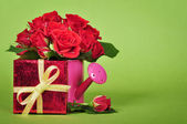 Red gift box with red roses — Stock Photo