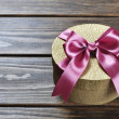 Stock Photo: Golden gift box