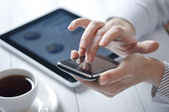 Touchphone in female hands — Stock Photo