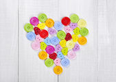 Colorful buttons in shape of heart — Stock Photo