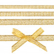 Gold bow and gold ribbons - Stock Photo