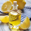 Lemon oil in a glass bottle — Stock Photo