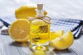 Lemon oil in a glass bottle — Stock Photo