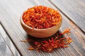 Saffron in wooden bowl — Stock Photo