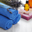 Blue towels and lavender flowers — Stock Photo