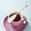 Tea in cup with candy sugar — Stock Photo