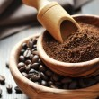 Ground coffee and coffee beans — Stock Photo