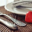 Cutlery and red stone heart — Stock Photo