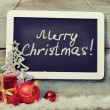 Slate board with Christmas decoration — Stock Photo #33243543