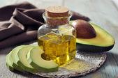 Bottle of avocado essential oil — Stock Photo