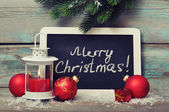 Christmas decoration and framed blackboard — Stock Photo