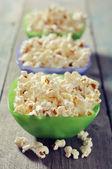 Popcorn in plastic bowls — Stock Photo