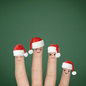 Fingers dressed in Santa hats — Stock Photo