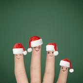 Fingers dressed in Santa hats — Foto de Stock