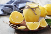 Lemon curd in glass jar — Stock Photo
