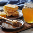 Honey in jar with honeycombs — Stock Photo