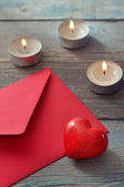 Red envelop with stone heart — Stock fotografie