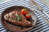 Grilled steak on plate — Photo