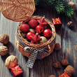 Christmas decorations in wicker basket — Stock Photo
