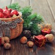 Christmas decorations in wicker basket — Stok fotoğraf