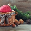 Christmas decoration in wicker basket — Stock Photo