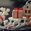 Gift box on sled — Stock Photo