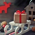 Gift box on sled — Stock Photo #36592141