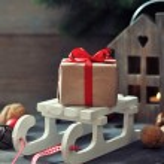 Gift box on sled — Stock Photo #36592149