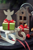Sled toy with gift boxes — Stockfoto