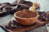 Carob powder — Stock Photo