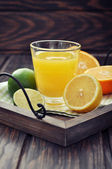 Citrus juice and fruits — Stock Photo