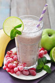 Banana smoothie with berries — Stock Photo