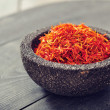 Saffron in stone bowl — Stock Photo #39348663