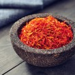 Saffron in stone bowl — Stock Photo #39348685
