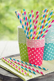 Paper cups and striped straws — Stock Photo