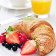 Fresh croissant with berries — Stock Photo