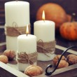 Candles with nuts and pumpkin — Stock Photo