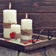 Candles with fabric hearts — Stock Photo #42297265
