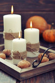 Candles with nuts and pumpkin — Zdjęcie stockowe