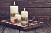 Candles with fabric hearts — Stock Photo