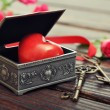 Stone heart in vintage gift box — Stock Photo
