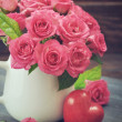 Pink roses with stone heart — Stock Photo #43400409