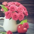 Pink roses with stone heart — Stock Photo