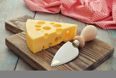 Cheese with big holes — Stock Photo