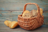 Bread and rolls in wicker basket — Stock Photo